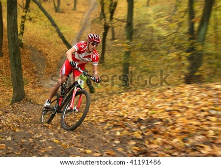 """UKRAINE, KIEV - OCTOBER 24: Vitaliy Shevchenko professional biker with blurred background, at the professional bicycle competition """"Dubki"""" closing, on October 24, 2009 at Ukraine, Kiev. - stock photo"""