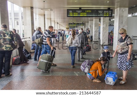 UKRAINE, KYIV - 27 Aug, 2014: Crowd of busy people inside the building of Central Railway Station, Kiev, Ukraine. Kiev's Central Railway Station serving 170,000 passengers per day. - stock photo