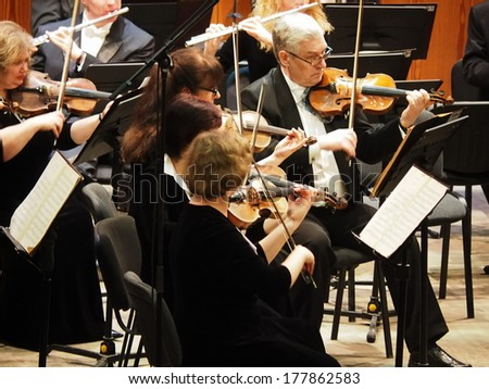 UKRAINE, LUGANSK - February 20, 2014: Lugansk Symphony Orchestra gave a concert in memory of the victims of armed clashes in Kiev. The conductor of the orchestra was Sergey Chernyak.  - stock photo