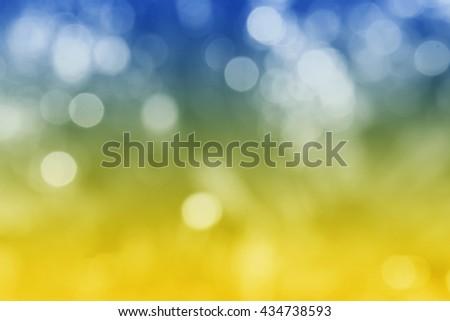 UKRAINE : National flag. Soft blurred bokeh natural background. Abstract gradient desktop wallpaper. - stock photo