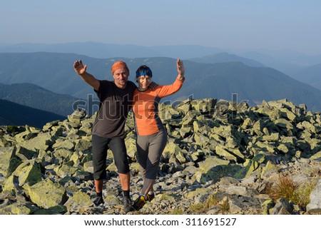 Ukrainian Carpathians. Happy hiker's couple hikers on top - stock photo