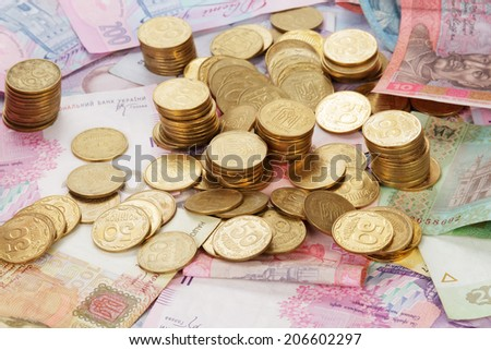 Ukrainian coins on banknotes - stock photo