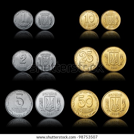 Ukrainian coins set front and tail side isolated on black - stock photo