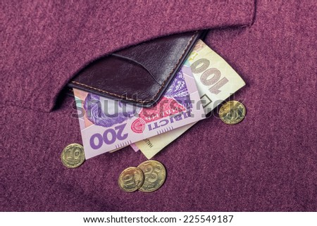 Ukrainian hryvnia and a penny in his pocket burgundy sweatshirts - stock photo