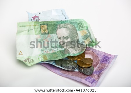 Ukrainian hryvnia and coins. / Bruising Ukrainian hryvnia currency and coins on a white background. - stock photo