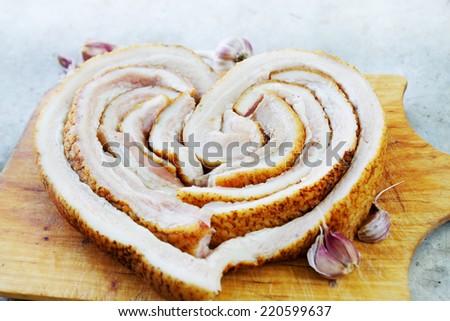 Ukrainian lard with garlic in the form of heart - stock photo