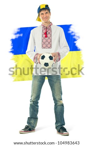 Ukrainian man in the national shirt with a ball and flag on a white background - stock photo