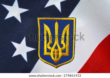 Ukrainian military chevron. With US Flag as background.on April 16,2015 in Kiev, Ukraine - stock photo