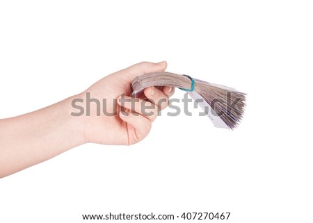 Ukrainian money fanned out in her hand isolated on white background - stock photo