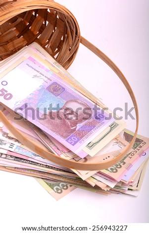 ukrainian money set in a basket - stock photo