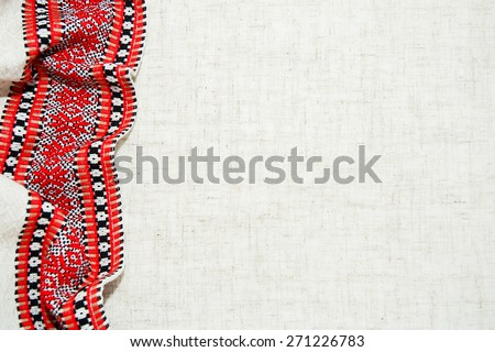 Ukrainian national embroidery cross on bleached linen with faggoting elements - stock photo