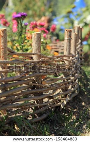 Ukrainian national fence/Ukrainian village in the summer - stock photo