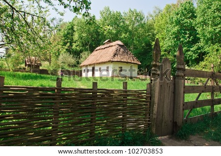 ukrainian old log hut in a forest - stock photo