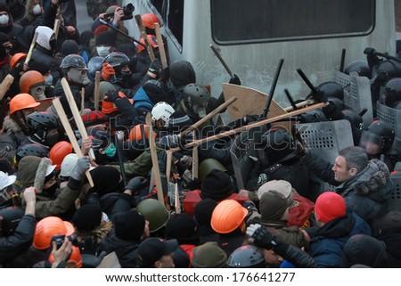 Ukrainian protesters beaten with sticks police. Kyiv, Ukraine, January 19, 2014 - stock photo