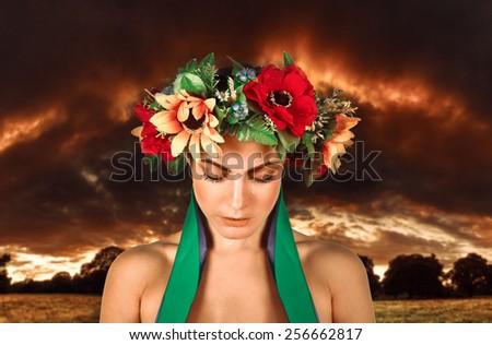 Ukrainian sad girl in a wreath - stock photo