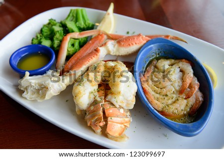 Ultimate seafood combo dinner served on plate - stock photo