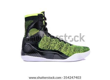 Ultra modern high-top green and black basketball shoe sneaker, isolated on white - stock photo