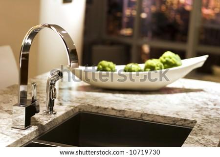 ultra modern kitchen window behind - stock photo