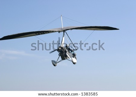 Ultralight taking off from an unmanned airfield in the early morning. - stock photo