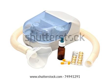 Ultrasonic nebulizer and medicines on a white background - stock photo
