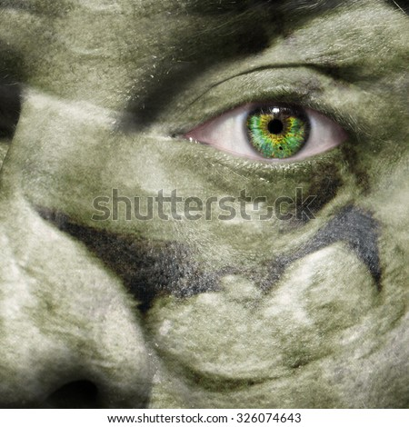 Ultrasound scan of a baby in utero at 12 weeks superimposed on a man's face as a concept for fatherhood - stock photo