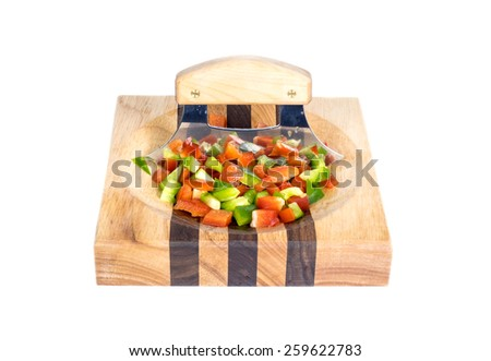 Ulu and Chopped Red and Green Bell Pepper on a Wooden Block Isolated on White - stock photo