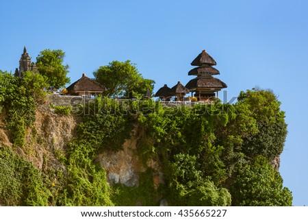 Uluwatu temple in Bali Indonesia - nature and architecture background - stock photo