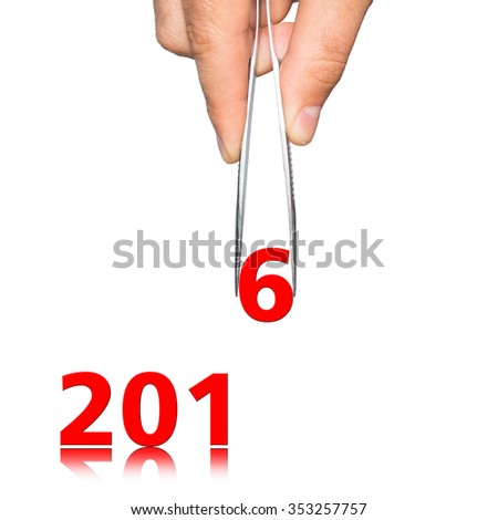 umbers 2016 and hand with tweezers on  background - stock photo