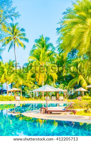 Umbrella and chair around beautiful luxury outdoor swimming pool in hotel resort - Boost up color Processing - stock photo