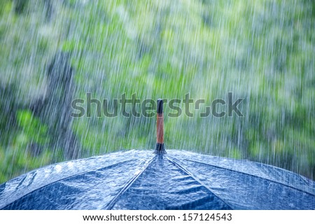 umbrella and rain drops closeup - stock photo