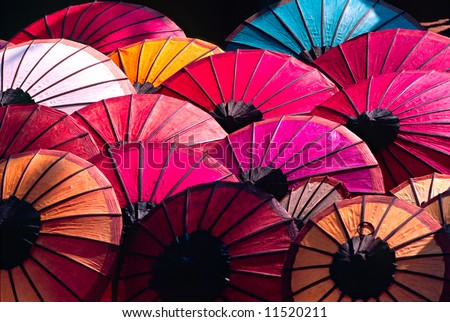 Umbrella at a tipical market, Luang Prabang,  Laos. - stock photo