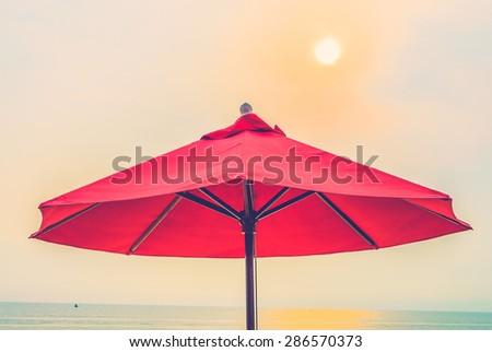 Umbrella beach - vintage filter - stock photo