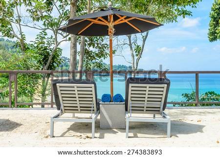 Umbrella chair on the beach - stock photo