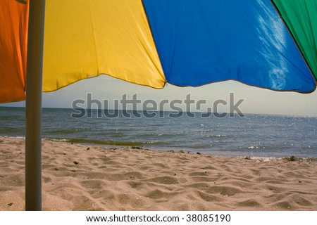 Umbrella on a beach - stock photo