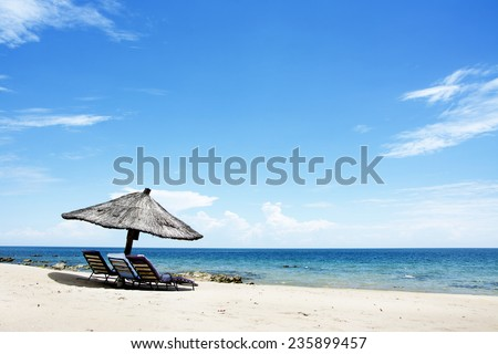Umbrella on the Beach on a Sunny Day, Chintheche Beach, Lake Malawi, Africa - stock photo