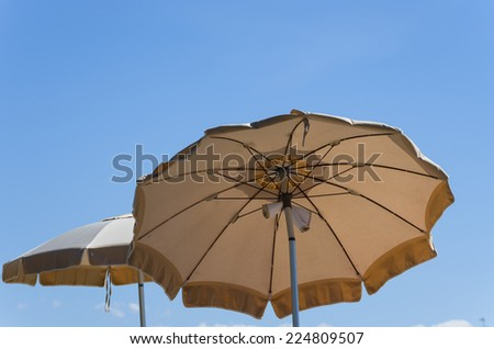 Umbrella protecting from the sun - stock photo