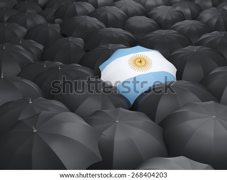 Umbrella with flag of argentina over black umbrellas - stock photo