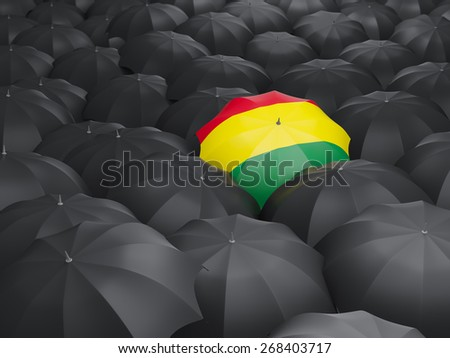 Umbrella with flag of bolivia over black umbrellas - stock photo