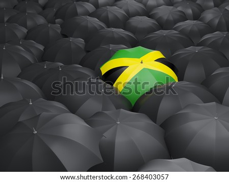 Umbrella with flag of jamaica over black umbrellas - stock photo