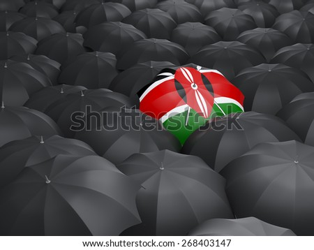 Umbrella with flag of kenya over black umbrellas - stock photo