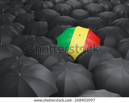 Umbrella with flag of republic of the congo over black umbrellas - stock photo