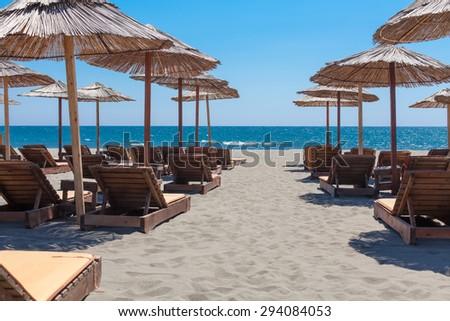 Umbrellas and beach chairs on the beach. Montenegro, Balkans.  - stock photo