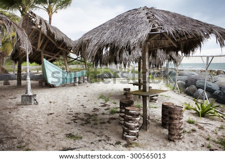 Umbrellas and chairs on the beach at the ocean - stock photo