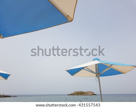 Umbrellas on the beach. The concept of summer vacation - stock photo