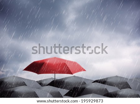 Umbrellas under rain and thunderstorm - stock photo