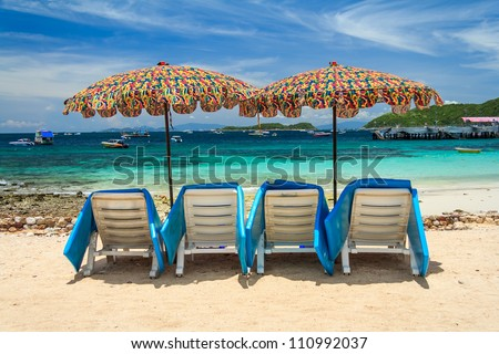 Umbrellas With Beach Chairs  Sea View - stock photo