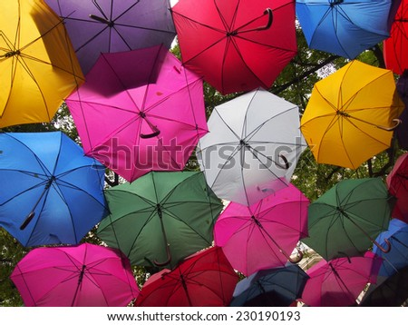 Umbrellas with different colors creating a colorful background - stock photo