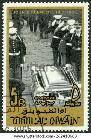UMM AL-QUWAIN - CIRCA 1965: A stamp printed in Umm al-Quwain shows Honor guard at tomb, John F. Kennedy (1917-1963), circa 1965 - stock photo