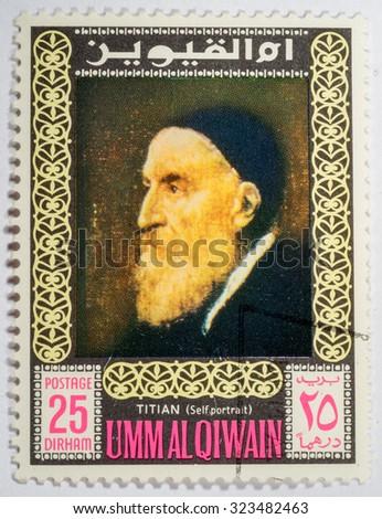 UMM - CIRCA 1967: A stamp printed in Umm al Qiwain shows a self-portrait of Titian, series, circa 1967 - stock photo