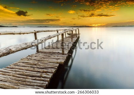 Un-know Jetty is the wooden jetty (pier), stretching almost 50 meter out to sea from the mangrove of Phuket Island.  - stock photo
